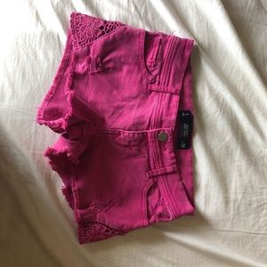 pink distressed shorts